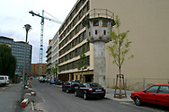 One of the last remaining East German watchtowers in former no-man's land stands as a reminder of the Cold War barrier in the centre of the city in amongst the building work behind Potsdamer Platz, Europe's biggest building site which has sprung up since the Wall was opened 15 years ago on 9th November 1989.
