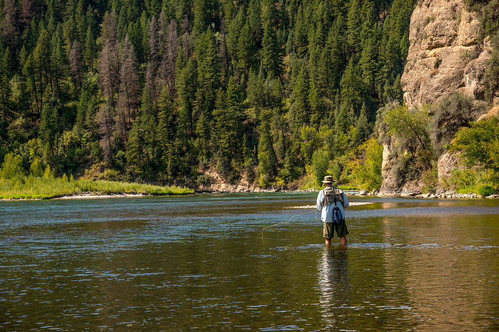 Fly fisherman lets his line float natural in the current of the South Fork of the Snake River in Eastern Idaho.  Licensing and Open Edition Prints. Released.
