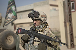 November 11, 2016 - Mosul, Nineveh, Iraq - A soldier, belonging to the Iraqi Army's 9th Armoured Division, stands guard as his unit visits Mosul's Al Inisar district on the south east of the city. The Al Intisar district was taken four days ago by Iraqi Security Forces (ISF) and, despite its proximity to ongoing fighting between ISF and ISIS militants, many residents still live in the settlement without regular power and water and with dwindling food supplies. (Credit Image: © Matt Cetti-Roberts via ZUMA Wire)