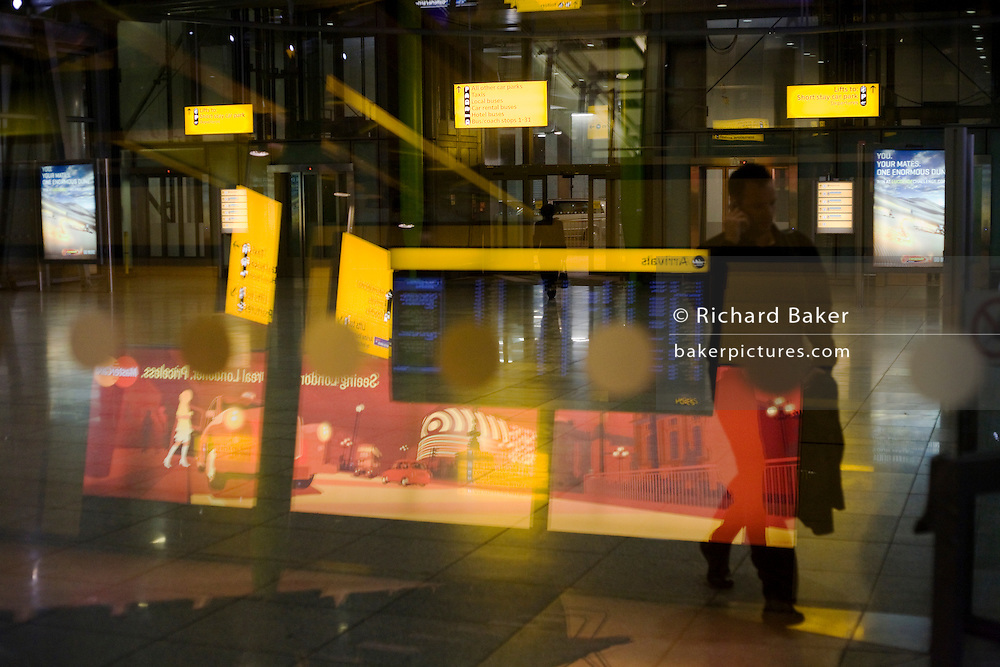 Evening sign and architecture atmosphere seen through large window glass at Heathrow's terminal 5.