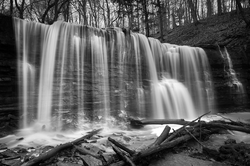 Short Hills Provincial Park located near St Catharine's; Ontario is a small park that contains some interesting waterfalls. While photographing my Lake Ontario project I spent time in the park exploring three different waterfalls. Webster Falls had a really good flow in early May. The composition was a difficult one because of all the fallen branches at the base of the falls. I was able through a lot of careful thought to adjust my location to make interesting shapes of the foreground logs. Also I made many exposures of the falls getting a good exposure that retained detail in the flowing water.