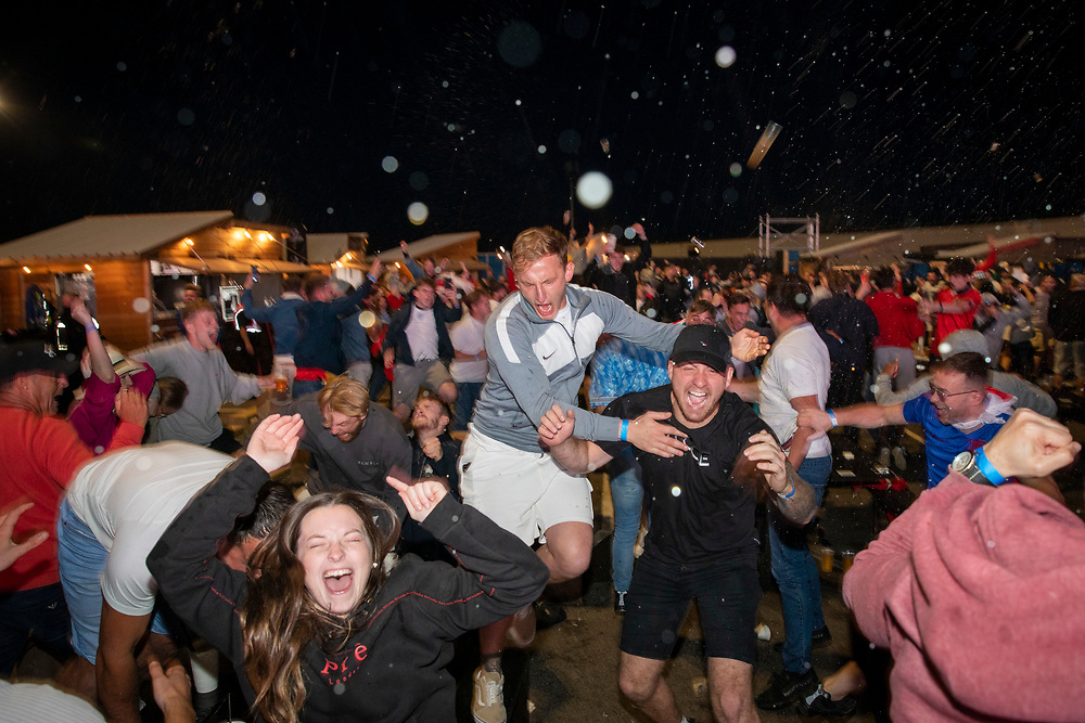England fans throw their drinks in the air after a goal during the Euro 2020 semi final match between England and Denmark on the 7th of July 2021 at the outdoor screen at Folkestone Harbour Arm, in Folkestone, United Kingdom. (photo by Andrew Aitchison / In pictures via Getty Images)