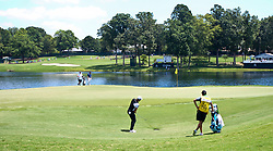 August 10, 2017 - Charlotte, North Carolina, United States - Danny Willett chips on to the 17th green during the first round of the 99th PGA Championship at Quail Hollow Club. (Credit Image: © Debby Wong via ZUMA Wire)