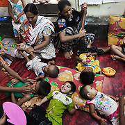 Children in a therapy sessions in Mirpur, Dhaka, run by the charity CSID.
