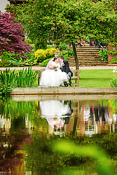 Bride and groom relaxing in the stunning grounds of St. Michael's Manor Hotel, St Albans.