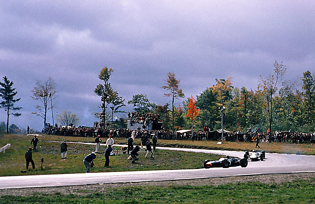 """Graham Hill (BRM no. 3) and Jim Clark (Lotus no. 5) at the """"Ninety"""" turn, 1965 USGP at Watkins Glen"""