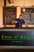 Scott O'Brien Kelley, co-owner of Paul O'Brien Winery, pours a glass of Pinot Noir in his tasting room in downtown Roseburg, OR.