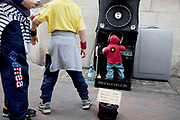 Minimix, a street perfomance / where a man / busker hiding in a speaker operates a miniature DJ working hihs decks and playing big beat and hip hop music. Incredibly popular in the area and an amusing take on busking.