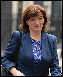 Nicky Morgan MP leaves No10 Downing after the Budget Cabinet meeting and just before The Chancellor George Osborne poses on the steps of No11 Downing street with his red budget box for the 2014 Budget, London, United Kingdom. Wednesday, 19th March 2014. Picture by Andrew Parsons / i-Images