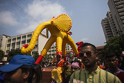 April 14, 2018 - Dhaka, Bangladesh - Clad in colourful attires thousands of people and students of the Faculty of Fine Arts of Dhaka University take part in the traditional Mongol Shobhajatra festooned with life-sized replicas brought out on Pohela Boishakh in Dhaka University on April 14, 2018. (Credit Image: © Ahmed Salahuddin/NurPhoto via ZUMA Press)