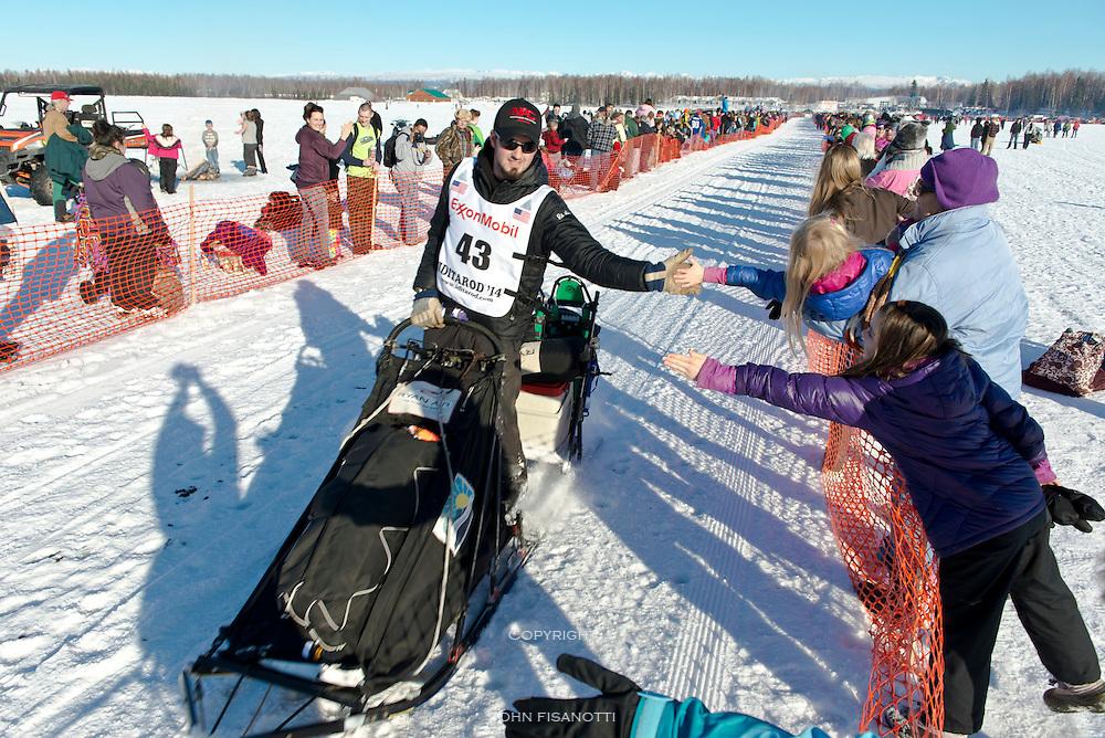 Race fans send Peter Kaiser off from Willow Alaska. 2014 Iditarod race.