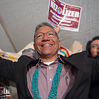 2018 Navajo Nation Vice Presidential candidate Myron Lizer, stands with his family and friends on the stage as they celebrate the final results of the Navajo Nation Presidential election on Tuesday in Window Rock.