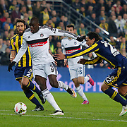 Fenerbahce's Bruno Eduardo Regufe Alves (R) and Besiktas's Demba Ba (C) during their Turkish superleague soccer derby Fenerbahce between Besiktas at the Sukru Saracaoglu stadium in Istanbul Turkey on Sunday 22 March 2015. Photo by Aykut AKICI/TURKPIX