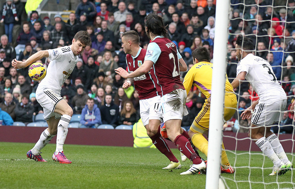 Despite calls from Burnley players, Swansea City's Federico Fernandez was judged not to have handled this ball into the Swansea City penalty area from a Burnley corner<br /> <br /> Photographer Rich Linley/CameraSport<br /> <br /> Football - Barclays Premiership - Burnley v Swansea City - Friday 27th February 2015 - Turf Moor - Burnley<br /> <br /> © CameraSport - 43 Linden Ave. Countesthorpe. Leicester. England. LE8 5PG - Tel: +44 (0) 116 277 4147 - admin@camerasport.com - www.camerasport.com