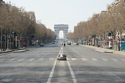 """March, 27th 2020 - Paris, Ile-de-France, France: Paris under confinement, Champs Elysees, and all public spaces virtually empty to stop the spread of the Coronavirus, during the eleventh day of near total lockdown imposed in France. The President of France, Emmanuel Macron, said the citizens must stay at home for at least 15 days, that has been extended. He said """"We are at war, a public health war, certainly but we are at war, against an invisible and elusive enemy"""". All journeys outside the home unless justified for essential professional or health reasons are outlawed. Anyone flouting the new regulations is fined. Nigel Dickinson"""