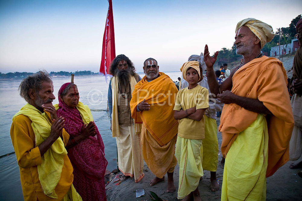 On the edges of the river Gandak ( a tributary of the Ganges), an elderly couple get married and are blessed (far left), Sonepur, Bihar, India.