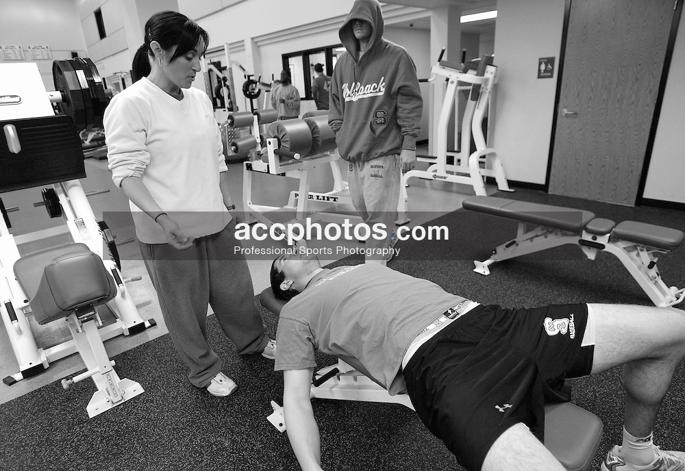 04 February 2007: North Carolina State Wolfpack RHP Andrew Brackman (40) talks with strength and conditioning coach Angie Montcalm while working out in the Weisiger-Brown weight-room in Raleigh, NC.