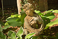 NC01345-00...NORTH CAROLINA -Small statue in the woodland section of the Elizabethan Gardens , at popular tourist attraction in Manteo on Roanoke Island.