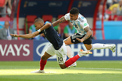 KAZAN, June 30, 2018  Kylian Mbappe (L) of France is fouled by Marcos Rojo of Argentina during the 2018 FIFA World Cup round of 16 match between France and Argentina in Kazan, Russia, on June 30, 2018. (Credit Image: © Lu Jinbo/Xinhua via ZUMA Wire)