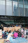 Filipino domestic workers gather on their day-off under the Hong Kong and Shanghai building in Central District, Hong Kong. Approximately 130,000 Filipino domestic servants work in Hong Kong and all have Sundays off.