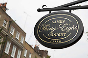 A old fashioned shop sign along Lambs Conduit Street on 13th October 2015 in London, United Kingdom. Lambs Conduit Street is a street in Bloomsbury in the West End of London. There are many independent traders along the street