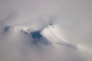 Aerial view of a mountain on the Greenland ice cap during a British mountaineering expedition to Knud Rasmussens Land, East Greenland, Arctic, 2006.