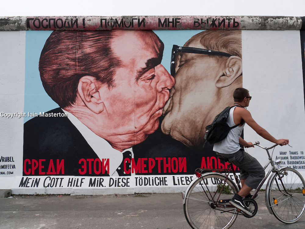 Newly repainted famous painting called The Kiss by Dmitry Vrubel on Berlin Wall at East Side Gallery in Berlin August 2009