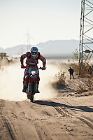 2x KTM motorcycle ridden by 2x Mike Brown/Quinn Cody pass race mile 58 in 2012 San Felipe Baja 250, San Felipe, Baja California, Mexico.