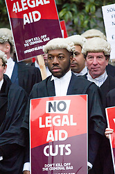 © Licensed to London News Pictures. 07/03/2014. Westminster, London, UK. Barristers gather at Old Palace Yard, Westminster to protest against government-propsed legal aid cuts as part of the Save UK Justice campaign. Photo credit : David Tett/LNP