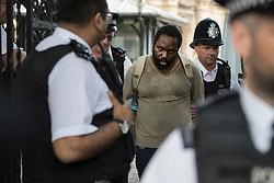 © Licensed to London News Pictures. 22/06/2017. London, UK. Police detain a man who earlier was tasered near an entrance to Parliament. Photo credit: Peter Macdiarmid/LNP