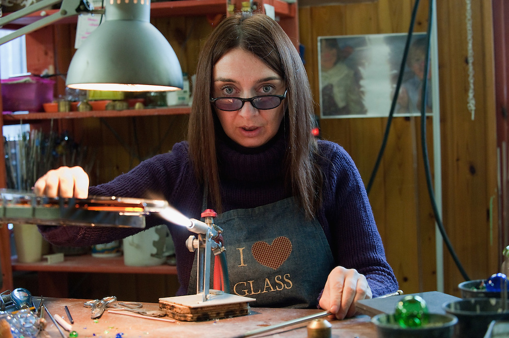 VENICE, ITALY - DECEMBER 18:  Elena Rosso a glass  artist in Murano heats a glass rod on a table burner on December 18, 2010 in Venice, Italy. There are only few female glass artists is Italy and they face continuous challanges in a traditionally male dominated field. .