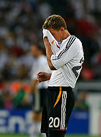 Photo: Glyn Thomas.<br />Germany v Portugal. Third Place Playoff, FIFA World Cup 2006. 08/07/2006.<br /> Germany's Lukas Podolski looks dejected.
