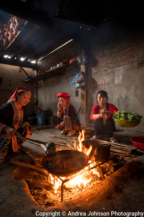 Man May Lo cooking lunch for our group inside Sa Mei walking on trial to her village Giang ta chai of the Red Dao hill tribe people outside of Sapa, Northern hill tribe areas, Vietnam