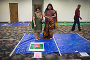 Mita Vora of Fremont, left, and Vaidehi Parekh of Evergreen judge the Diwali Rangoli competition at the Shreemaya Krishnadham Temple in Milpitas, California, on November 2, 2013. (Stan Olszewski/SOSKIphoto)