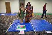 Mita Vora of Fremont, left, and Vaidehi Parekh of Evergreen judge the Diwali Rangoli competition at the Shreemaya Krishnadham Temple in Milpitas, California, on November 2, 2013. (Stan Olszewski/SOSKIphoto)