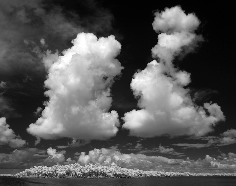 Clouds over mangroves photographed using infrared Canon 5D Mark II camera in Florida's Everglades National Park out of Chokoloskee Island and the 10,000 Islands National Wildlife Refuge. Photo/Andrew Shurtleff