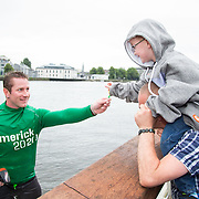 08.06.2016        <br /> Scotty Knemeyer showing his support for the Limerick 2020 bid as he handed out lollies to children during his Limerick 2020 spectacular flyboard show over the River Shannon at Clancy Strand. Receiving a lolly from Scotty was Callum Swords aged 5, Ballynanty Limerick. Picture: Alan Place