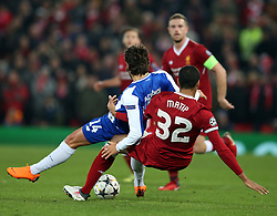 March 6, 2018 - Liverpool, U.S. - 6th March 2018, Anfield, Liverpool, England; UEFA Champions League football, round of 16, 2nd leg, Liverpool versus FC Porto; Goncalo Paceincia of Porto is fouled from behind by Joel Matip of Liverpool   (Photo by Dave Blunsden/Actionplus/Icon Sportswire) ****NO AGENTS---NORTH AND SOUTH AMERICA SALES ONLY****NO AGENTS---NORTH AND SOUTH AMERICA SALES ONLY* (Credit Image: © Dave Blunsden/Icon SMI via ZUMA Press)
