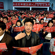 """Students and teachers study """"Crazy English"""" at the Petrochemical University in Beijing, as part of the city's effort to get ready to host the 2008 Olympics."""