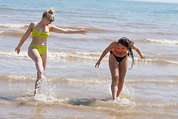 © Licensed to London News Pictures. 07/08/2020. Bridlington, UK. Tegan Bibby and Evania Ryan, enjoy the hot weather on Bridlington beach this afternoon.  The UK is set to bask as temperatures today will reach 36 degrees Celsius in the capital during a mini heatwave. Photo credit: Ioannis Alexopoulos/LNP
