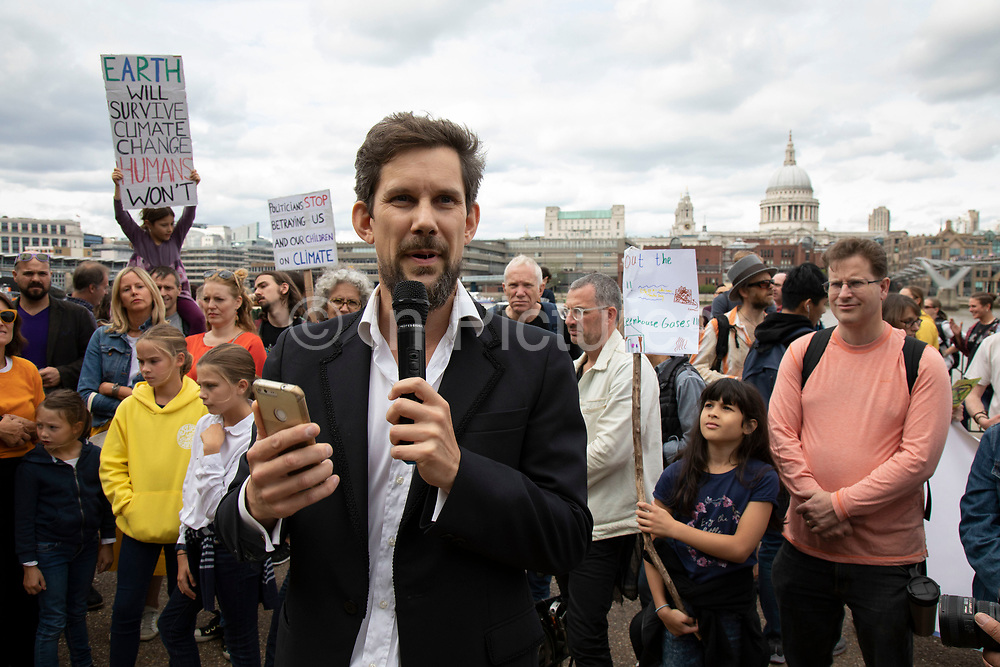 Adam Woodhall, from Inspiring Sustainability speaks at the Rise For Climate Change event held outside Tate Modern in London, England, United Kingdom on September 8th 2018. Tens of thousands of people joined over 830 actions in 91 countries under the banner of Rise for Climate to demonstrate the urgency of the climate crisis. Communities around the world shined a spotlight on the increasing impacts they are experiencing and demanded local action to keep fossil fuels in the ground. There were hundreds of creative events and actions that challenged fossil fuels and called for a swift and just transition to 100% renewable energy for all. Event organizers emphasized community-led solutions, starting in places most impacted by pollution and climate change. Photographed for 350.org