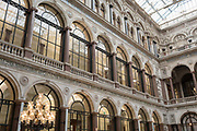 The architecture of the covered Durbar Court, inside the Foreign and Commonwealth Office FCO and part of the former India Office, on 17th September 2017, in Whitehall, London, England. The main Foreign Office building is in King Charles Street, and was built by George Gilbert Scott in partnership with Matthew Digby Wyatt and completed in 1868 as part of the new block of government offices which included the India Office and later 1875 the Colonial and Home Offices. George Gilbert Scott was responsible for the overall classical design of these offices but he had an amicable partnership with Wyatt, the India Office's Surveyor, who designed and built the interior of the India Office.