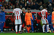 Alex Oxlade-Chamberlain of Liverpool receives a yellow card from referee Martin Atkinson. Premier league match, Stoke City v Liverpool at the Bet365 Stadium in Stoke on Trent, Staffs on Wednesday 29th November 2017.<br /> pic by Chris Stading, Andrew Orchard sports photography.