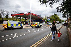 © Licensed to London News Pictures. 14/05/2021. Oldham, UK. GV of the scene where Greater Manchester Police say they were called to reports of a shooting at a Texaco petrol station on Hollins Road last night (13th May 2021). Photo credit: Joel Goodman/LNP