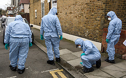 © Licensed to London News Pictures. 03/04/2018. London, UK. Member son a police search team, search the scene on Chalgrove Road, Tottenham, north London where a 17 year old girl was shot dead. The girl was found with a bullet wound and pronounced dead at the scene at 21:43 last night. Photo credit: Ben Cawthra/LNP