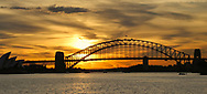 A view of the Sydney Bridge at sunset.
