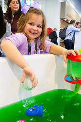 Four year-old Mia Johnson plays with jelly at the Toy Fair at Kensington Olympia in London, the UK's largest dedicated game and hobby exhibition featuring the hottest and most anticipated products for the year ahead. London, January 22 2019.