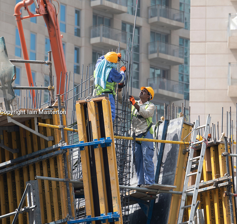 Construction workers on site building new high rise luxury apartment building art Downtown Dubai, UAE, united Arab Emirates