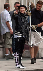 ©London News Pictures. 15/01/2011 Picture Credit Should read Neil Hall/London News Pictures.Madonna directs her new period film W.E. starring Abbie Cornish about the abdication of King Edward in London on 08/08/2010. Madonna gestures as she directs the actors