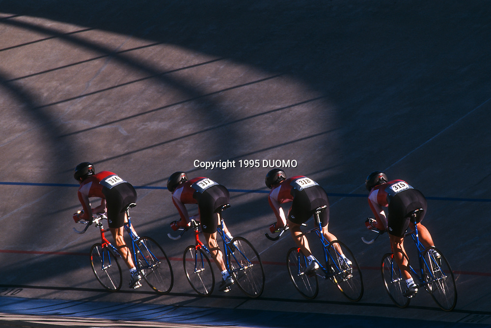 Male cycling team on the velodrome.